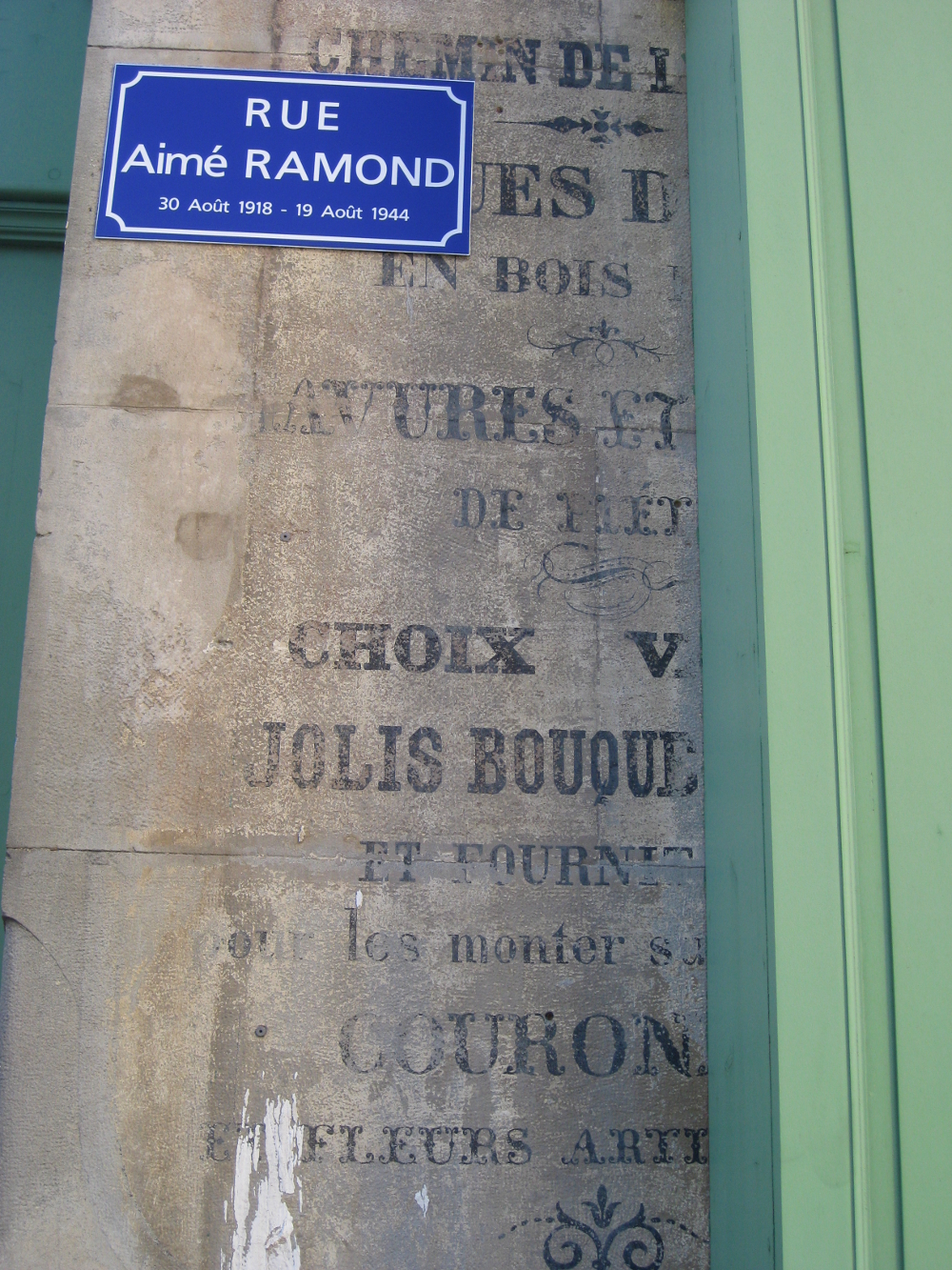 Old shop signage in the bastide town of Carcassonne, France