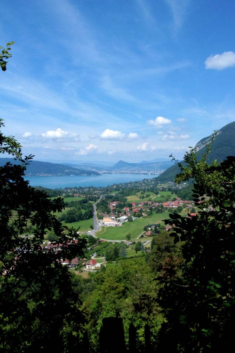 Lake Annecy, France: A practical guide to planning your travel and accommodation | View of Annecy from Talloires | Travel guide | Girl with a saddle bag blog